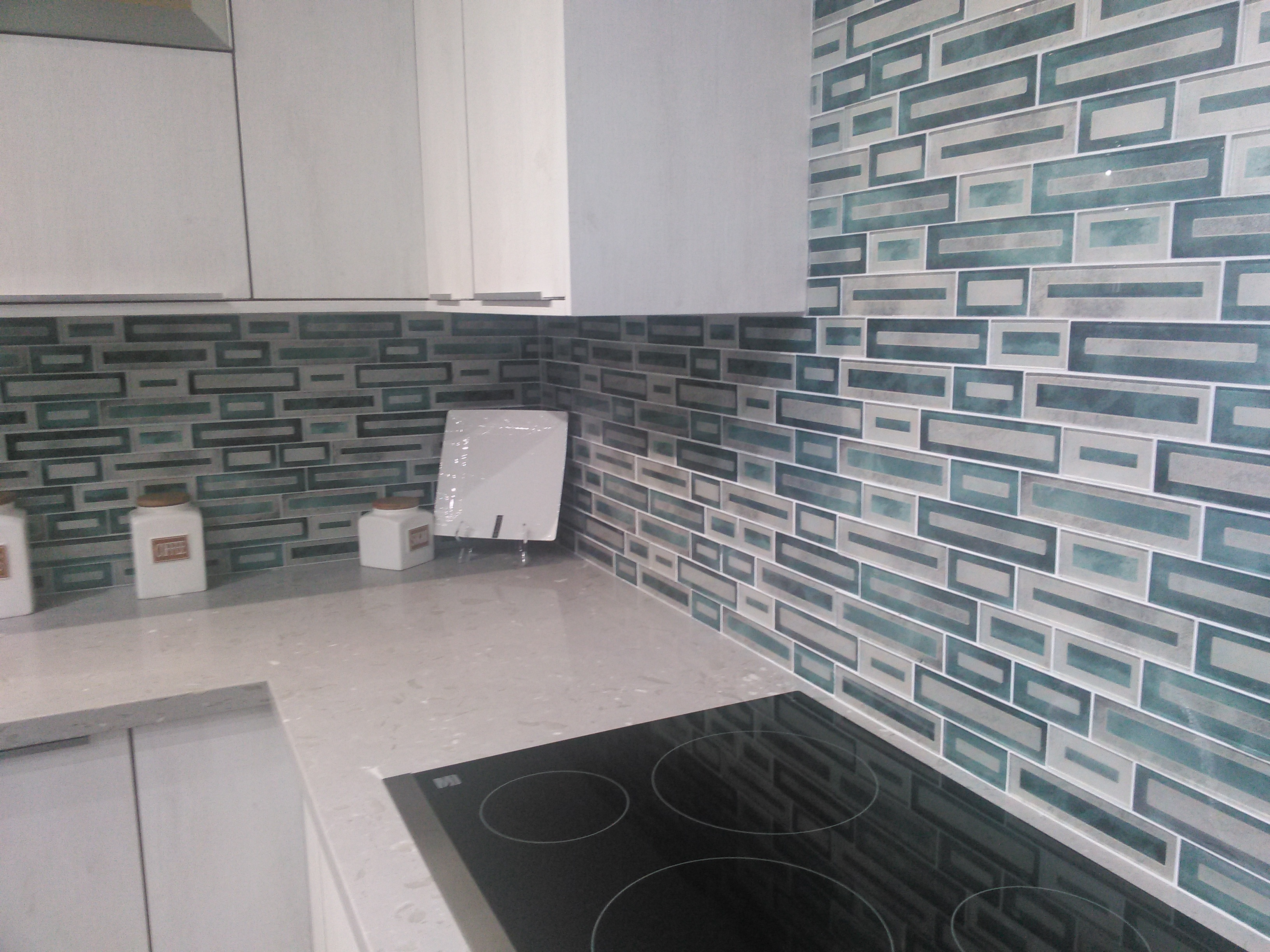 colorful-tile-kitchen-backsplash-white-european-cabinets