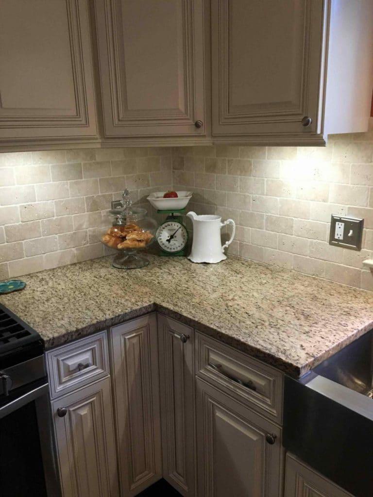 Taupe Kitchen Cabinets Off White Brick Backsplash Corner