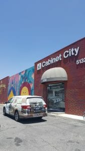 cabinet-city-storefront-with-van-and-mural